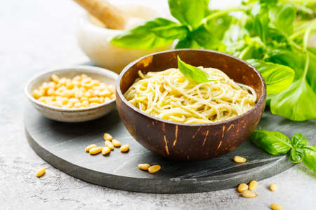 Pasta with Basil pesto, cheese and pine nuts, Selective focus.