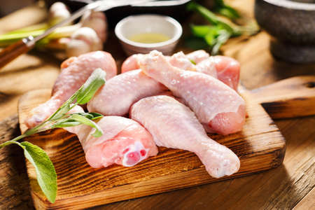 Raw chicken legs for cooking with herbs Reklamní fotografie