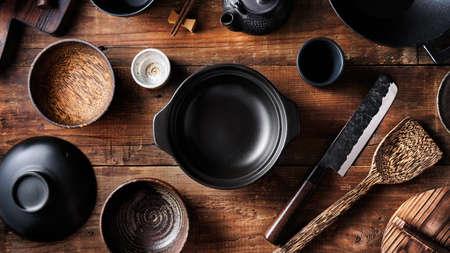 Set of dishes for Asian cuisine, pot, bowls, wok, Japanese knife