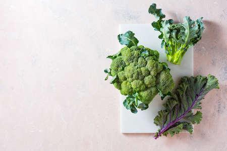 Broccoli and Kale leaves on a marble board. Reklamní fotografie