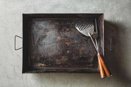 Empty baking sheet with fork and Spatula for Grill, Top view. Reklamní fotografie - 129271762
