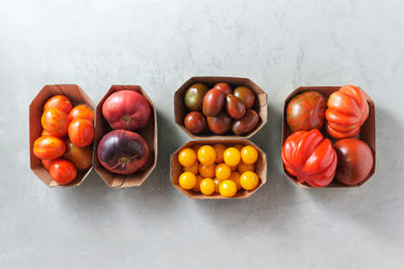 Cherry tomatoes and other varieties of tomatoes in little trays, Organic vegetables