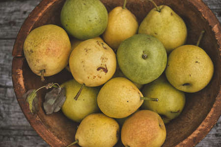 Yellow ripe pears in a bowl