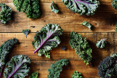 Freshly cut purple Kale leaves on a wooden background. Clean food. Healthy product.
