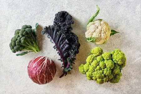 Cabbage of different varieties on a light background, cauliflower, radicchio, broccoli, Kale. Reklamní fotografie - 132180177