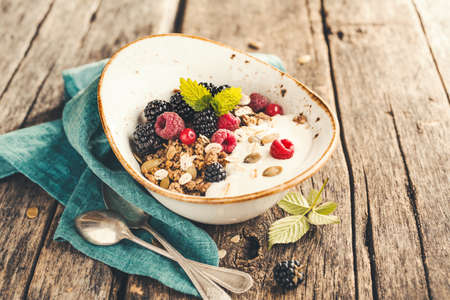 Delicious and healthy Breakfast with homemade granola. Selective focus.