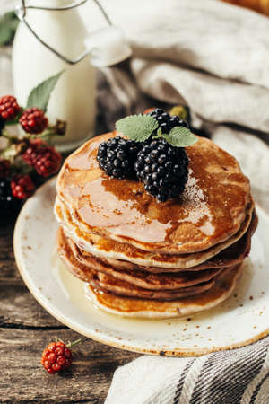 Stack of pancakes with fresh blackberry, Close up.