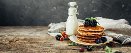 Stack of pancakes with fresh blackberry, Food background with copy space.