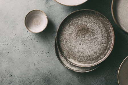 Empty ceramic bowls and plates