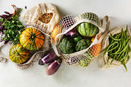 Reusable shopping bags with organic eco vegetables. Stock fotó