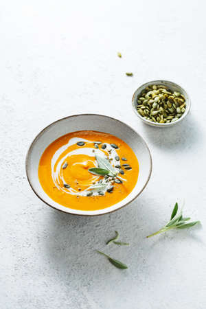 Spicy vegetable soup with pumpkin seed and fresh herbs.