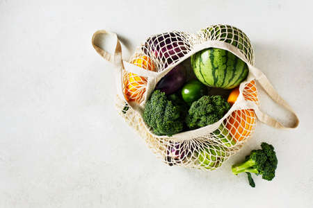 Reusable shopping bags with vegetables, eggplant, broccoli, watermelon. Top view. Copy space Stock fotó