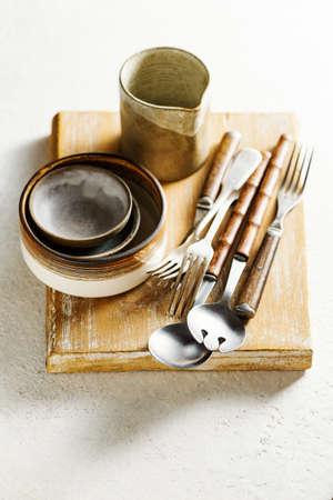 Modern ceramic tableware and old utensils.