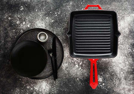 Cast iron pan and modern tableware