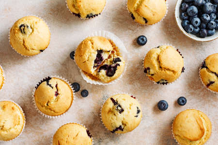 Delicious blueberry muffins and fresh berries. Top view. Stock fotó