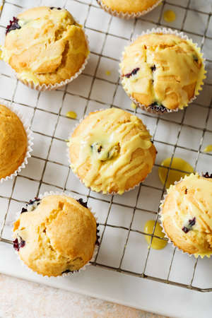 Homemade blueberries muffins with lemon frosting, close up. Top view. Stock fotó - 156155953