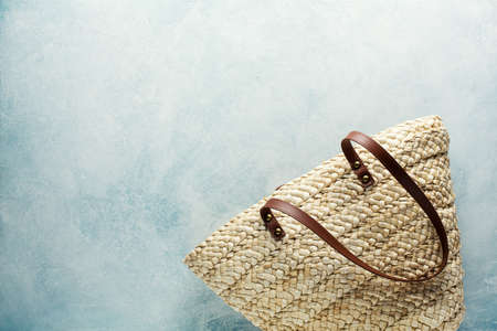 Beach bag on a blue background. Top view, copy space. Stock fotó - 156155964