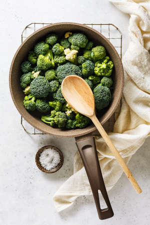Fresh broccoli in a pan on a light background. Clean food. Top view. Stock fotó - 156155990