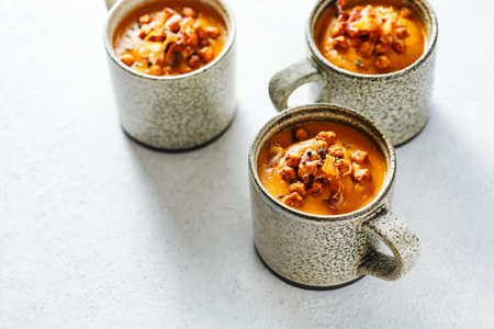 Hearty winter soup in mugs with sweet potatoes and spices Stock fotó - 156156005
