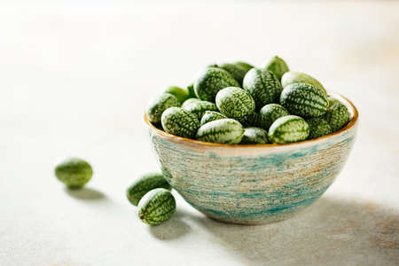 Freshly harvested cucamelons in bowl. Selective focus. Stock fotó - 156156009