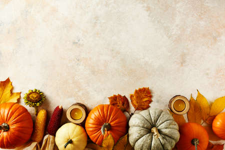 Autumn holiday background with pumpkins, colorful leaves, corn and candles. Top view. Copy space. Stock fotó - 156353482