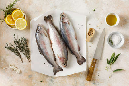Fresh trouts with herbs and spices and lemon. Stock fotó - 156488201