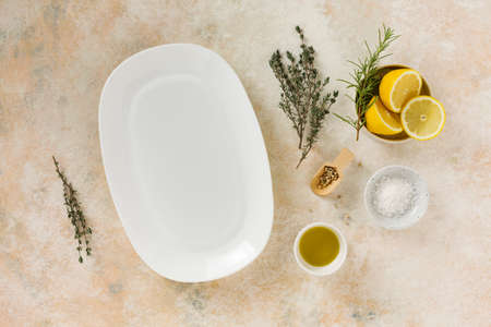 Empty white dish and cooking ingredients Stock fotó - 156528672