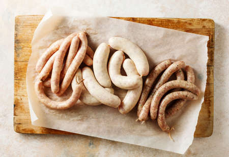 Three types of raw barbecue sausages