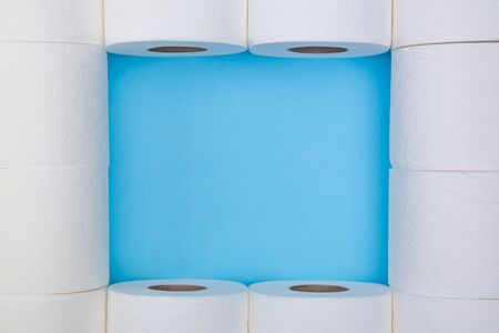 Toilet paper rolls frame on a blue background. Do not panic. Do not worry. Stay home.