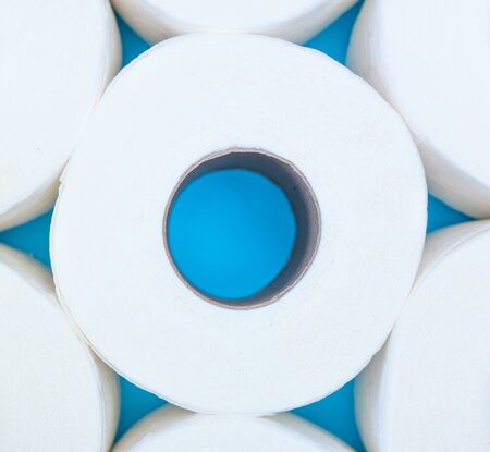 Toilet paper rolls side by side like a flower top view. Do not panic. Do not worry. Stay home.