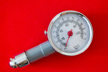 Car Bike Tire Tyre Pressure Gauge Manometer with red arrow on a red background.