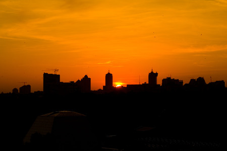 sunset over the big city. The silhouette of the big city Stock Photo