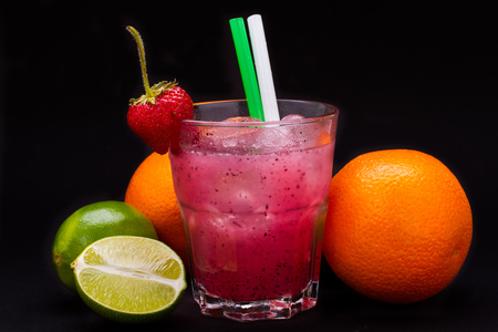 daiquiri alcohol: strawberry cocktail in glass on black background Stock Photo