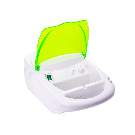 inhaler compressor nebulizer. White, green on white background Stock Photo