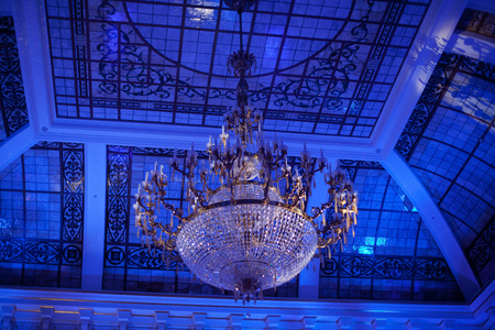 large beautiful crystal chandelier in the interior.