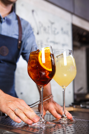 Barman at work, preparing cocktails. concept about service and beverages In the kitchen in the restaurant