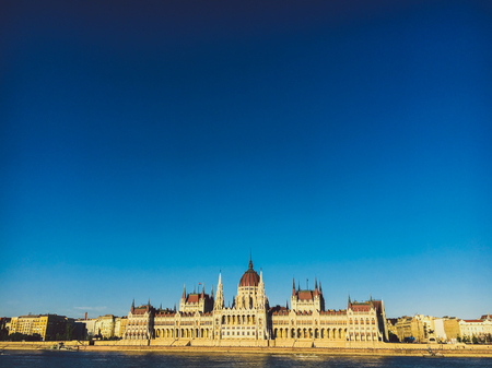 Evening sun on the facade of the Parliament building across Danube river, Budapest, Hungary. Reklamní fotografie