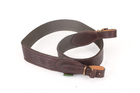 armored brown leather belt on white isolated background.