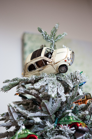 Christmas decoration. Toy car on the road near the tree