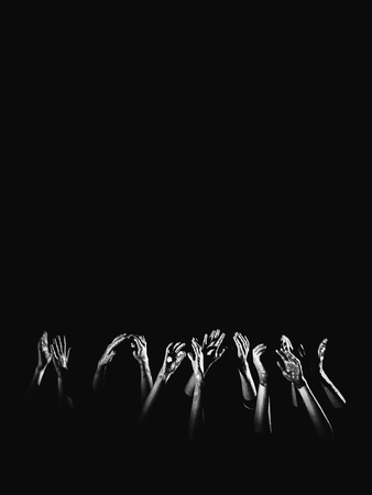 banner social concept. hands in paint raised up on a black background symbolizing fear, hope, struggle and a request for help. Place for text, copyright. Stock Photo