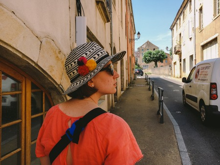 July 18, 2017 France city of Cluny, the region of the Burgundy: People tourists are walking along the old narrow street of the central part of the city in hot, sunny summer weather.
