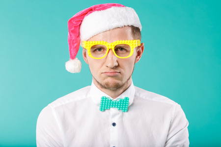 New Year theme Christmas winter holidays office company employees. portrait Caucasian male business funny Santa Claus hat glasses posing emotion discontent, disappointment tired, rest evening party.