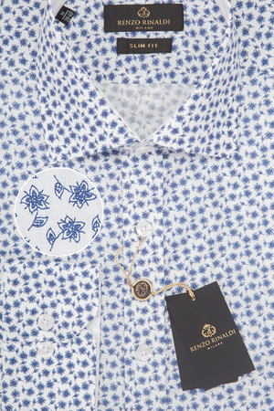 Mens shirt in packing close-up macro top view.