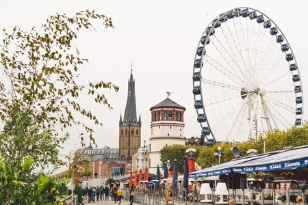 25 October 2018 Germany, Dusseldorf. North Rhine. City center, the embankment of the river. Saray Town Hall and the Ferris Wheel in the fall in overcast weather.