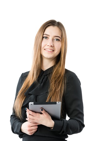 Woman business technology theme. Beautiful young caucasian woman in black shirt posing standing with tablet hands on white isolate background. Profession Marketer Sales Social Media Advertising. Archivio Fotografico