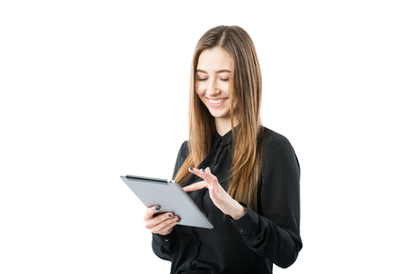 Woman business technology theme. Beautiful young caucasian woman in black shirt posing standing with tablet hands on white isolate background. Profession Marketer Sales Social Media Advertising. Stock Photo