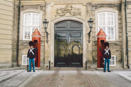 February 20, 2019. Denmark. Copenhagen. Amalienborg Square. Changing the royal guard. Army ranks uniform people defense castle king