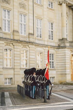 February 20, 2019. Denmark. Copenhagen. Amalienborg Square. Changing the royal guard. Army ranks uniform people defense castle king