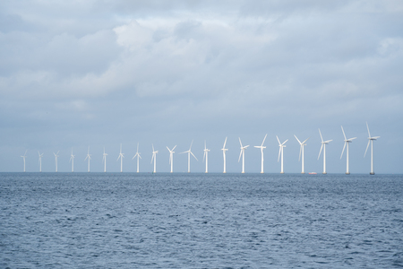 The theme is net power generation and environmental protection. A number of wind blades, wind power in the Baltic Sea in Europe Denmark Copenhagen in winter. Stock Photo