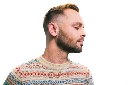 Portrait of a young caucasian stylish and fashionable man with a beard. Homosexual man, model posing.